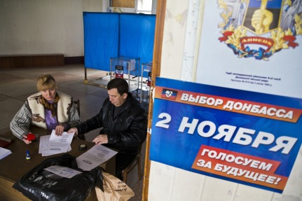 Election workers prepare ballots in the Donetsk Peoples' Republic